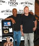 Mike Tyson and Tom Goldsbury, founder of Off The Strip, with Mike Tyson Bitcoin ATM