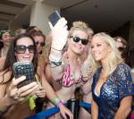 Kendra Wilkinson-Baskett takes photos with fans at WET REPUBLIC