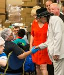 Carlos Santana tours Opportunity Village's Ralph and Betty Engelstad Campus and meets with OVIPs on Tuesday, September 15, 2015, where he and longtime associate Hermes Music donated more than 60 instruments.