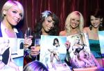 """A few of the girls showing off their month in the 2012 """"Ultimate FANTASY"""" calendar."""