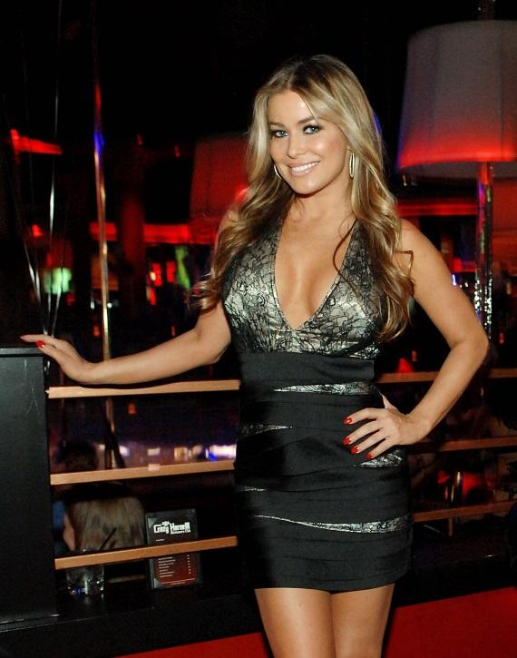 Carmen Electra posing in front of ice luge