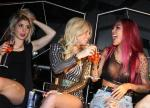 Chanel West Coast toasts alongside friend and DJ Kittie (right) while partying at Moon Nightclub