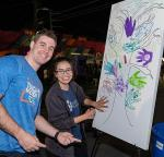 A paint-by-numbers mural was painted by the community at First Friday in the Credit One Bank booth