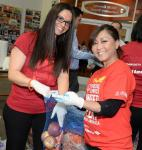 More than 40 Bank of America employees sorted and packed food for local families in-need