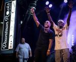 Flava Flav joins Nelly on stage during Downtown Rocks concert series at Fremont Street Experience
