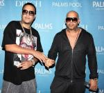 """French Montana and Mally Mal shake hands while arriving to """"Ditch Fridays"""" pool party at Palms Casino Resort"""