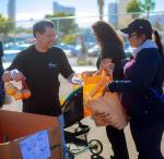 Volunteers from Wynn Las Vegas help deliver groceries to families in need at Rex Bell Elementary School, Wednesday, Oct. 24