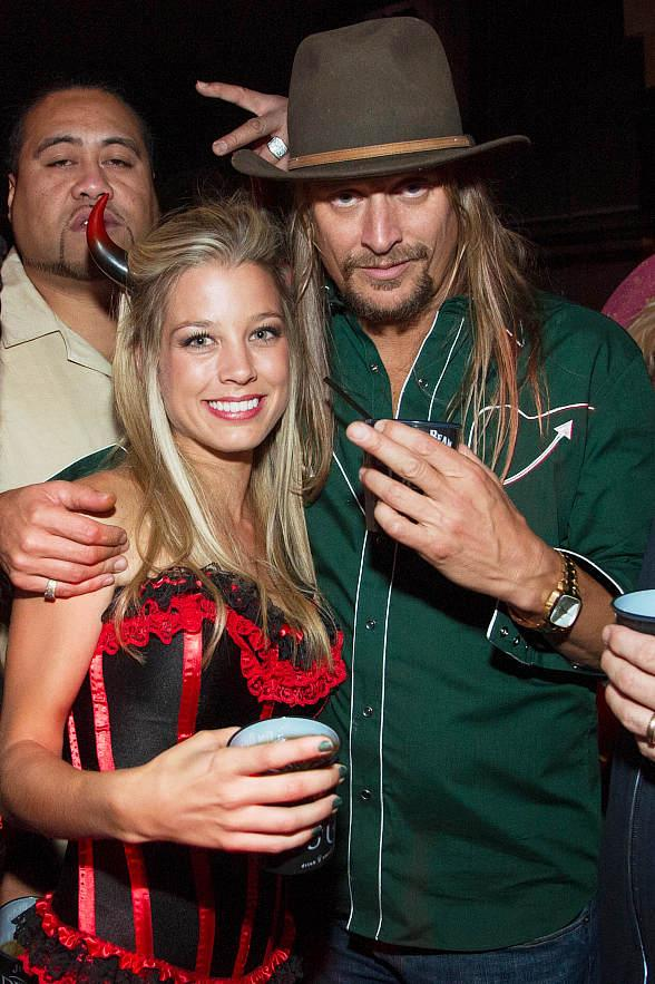 Kid Rock with a sexy little devil at LAVO