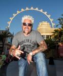 Guy Fieri at The LINQ Promenade with the High Roller in the background