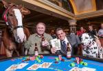 World-famous Budweiser Clydesdale Elite, South Point Hotel, Casino & Spa Owner Michael Gaughan, Budweiser Dalmatian King, and South Point Hotel, Casino & Spa General Manager Ryan Growney enjoy a hand of blackjack on the South Point casino floor