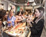 Store Director Elayna Gibson Talks To Guests at ALEX AND ANI's Fashion Show Grand Opening