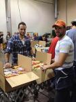 Wranglers players help sort and pack over 100 boxes of food for families in the community