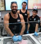 Thunder From Down Under cast members pose with rolled ice cream