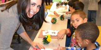 United Way of Southern Nevada's Young Philanthropists Society Volunteer Co-Chair Nikki Giroux helped children with crafts during the holiday party for Hollingsworth Elementary School's students on Friday, Dec. 17