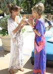 Vanessa and Jennifer eating cupcakes both in Hale Bob coverups