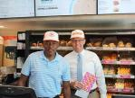 Commissioner Lawrence Weekly and City of North Las Vegas Mayor Pro Tempore Scott Black Prepare to Greet Dunkin' Guests for Official Grand Opening Event