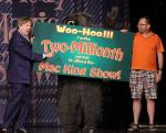 Mac King (left) and a furry friend congratulates lucky two-millionth audience member, Kevin Pogoda, from Virginia on Tuesday, June 23, 2015 at Harrah's Las Vegas