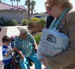 Mayor Carolyn Goodman delivering to Frances Pemberton (Meals on Wheels client) and her grandson