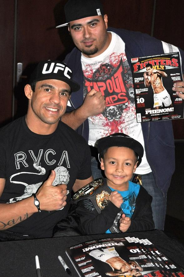 UFC fighter Vitor Belfort autographs Fighters Only Magazine for fans