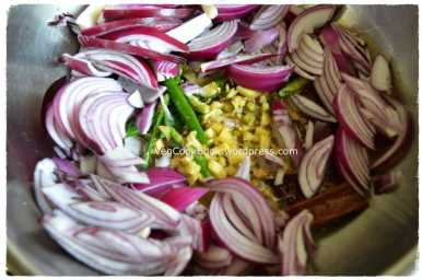 GreenChillies,Onions and Ginger added to frying pan