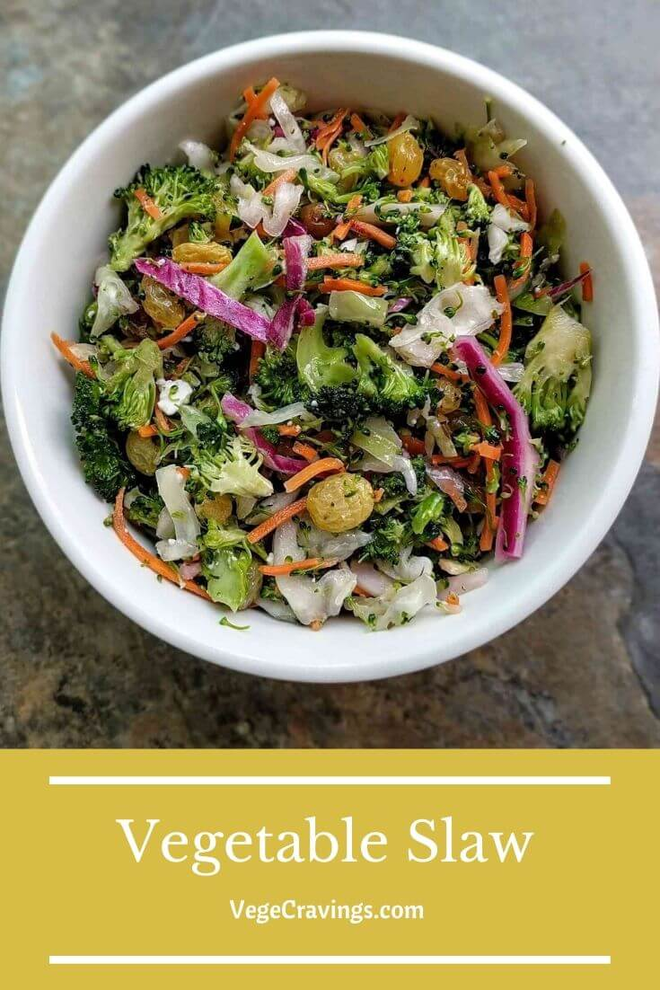 Vegetable Slaw is a healthier and colorful variation of Coleslaw, made of fresh, crunchy vegetables tossed in a mayonnaise & vinegar dressing.