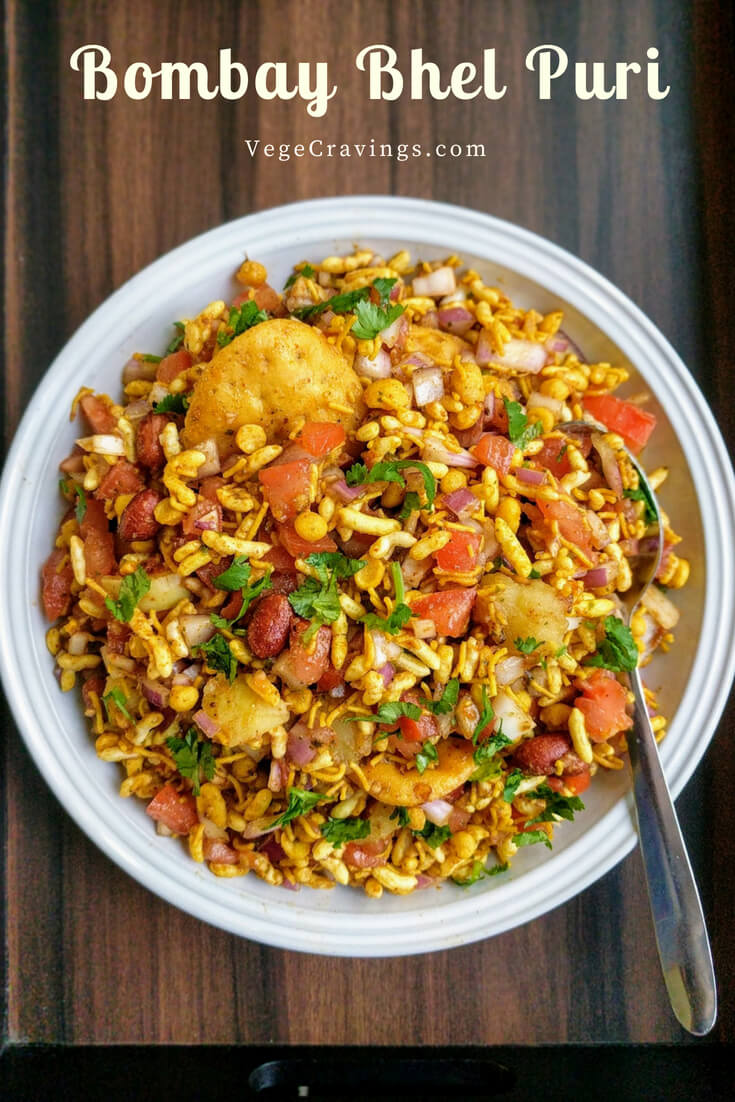 Bhel Puri is a popular Indian snack made with puffed rice, vegetables like boiled potatoes, tomatoes & onions, flavored with tangy chutneys.