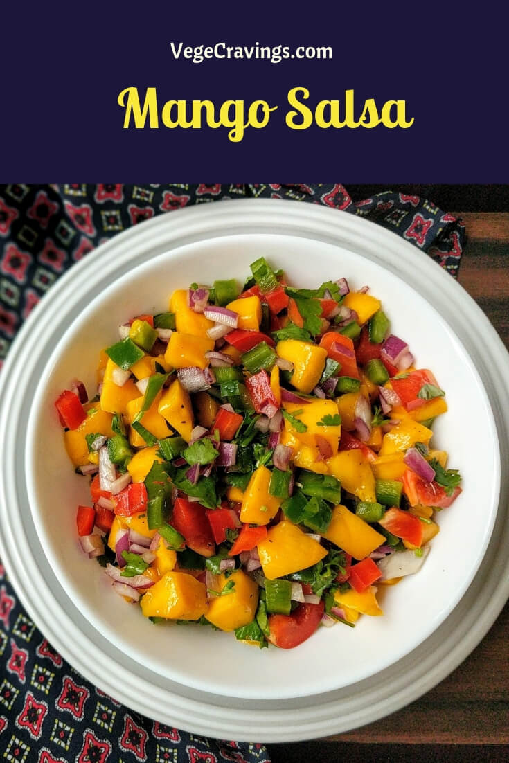 Mango salsa is a delicious and colorful recipe made with fresh ripe mangoes, onions, bell peppers, jalapeños & cilantro. Easy, tangy & tasty!