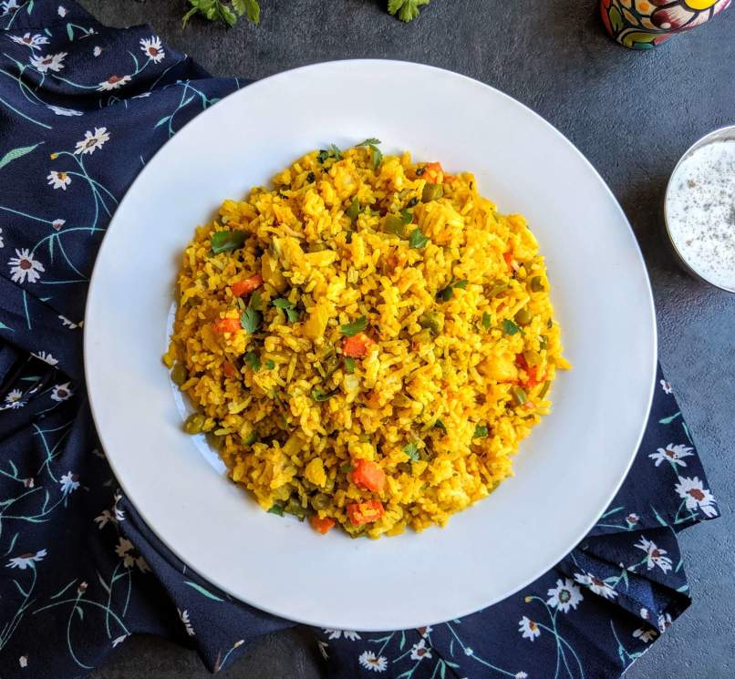 Tawa pulao is a spicy and popular street food from Mumbai, made with rice cooked with vegetables and flavored with pav bhaji masala.