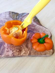 Coring an orange bell pepper