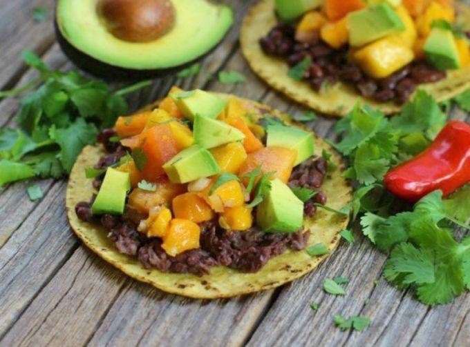 Bean tostadas with tropical fruit salsa and avocado