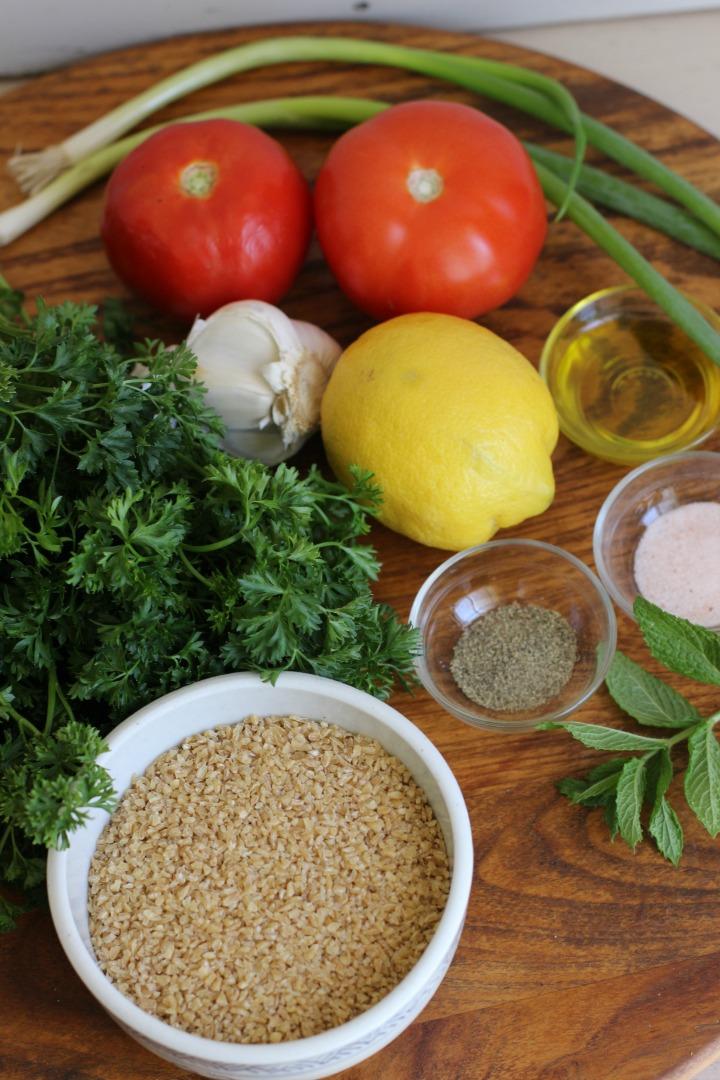 image of tomatoes, green onions, lemon, garlic, parsley, mint, bulgur, salt and pepper