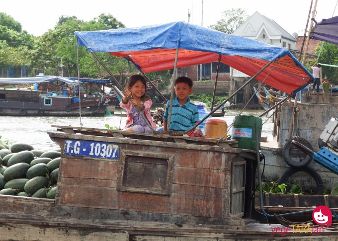 Kids at the floating market on the Mekong Delta