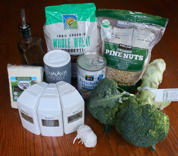 Ingredients for whole wheat pasta with broccoli, artichoke and feta