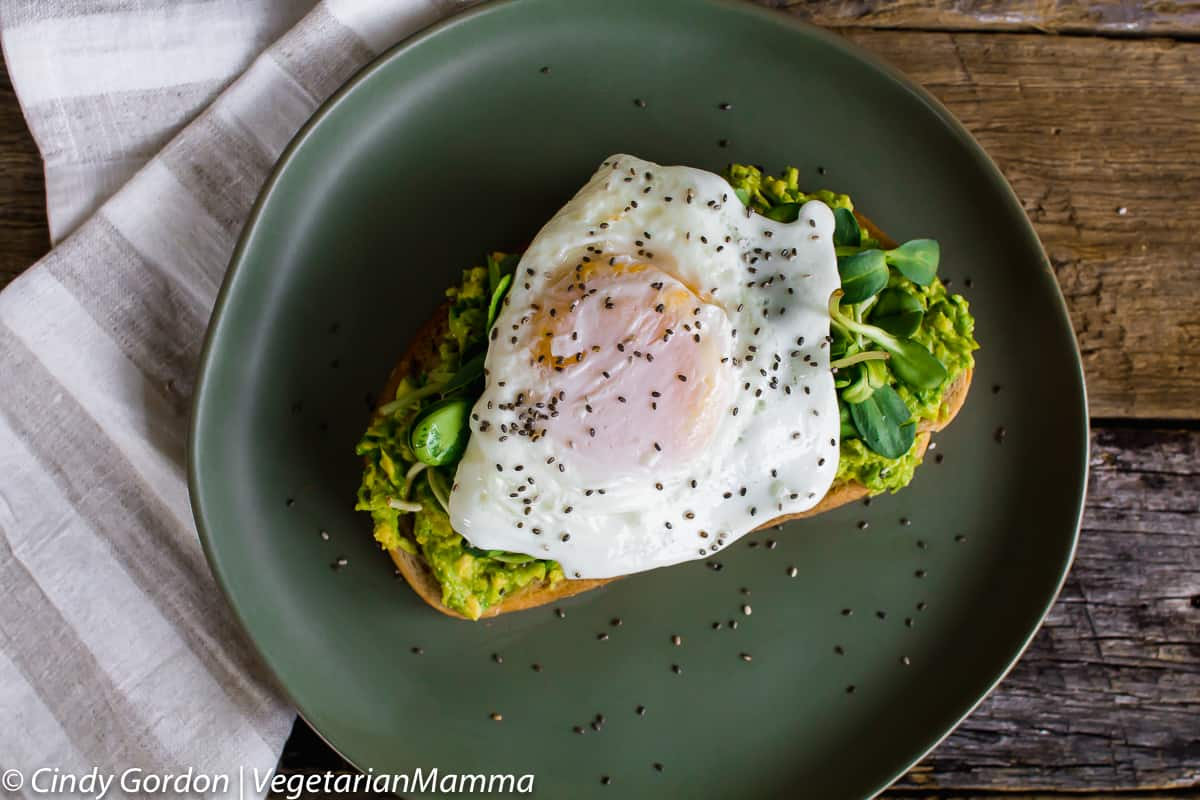 Fried Egg Avocado Toast topped with chia seeds