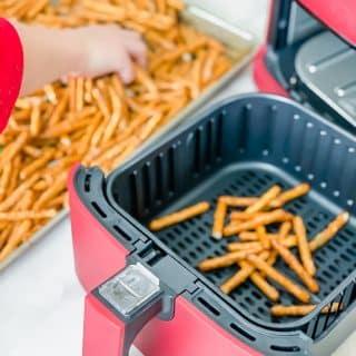 air fryer seasoned pretzels in the air fryer basket