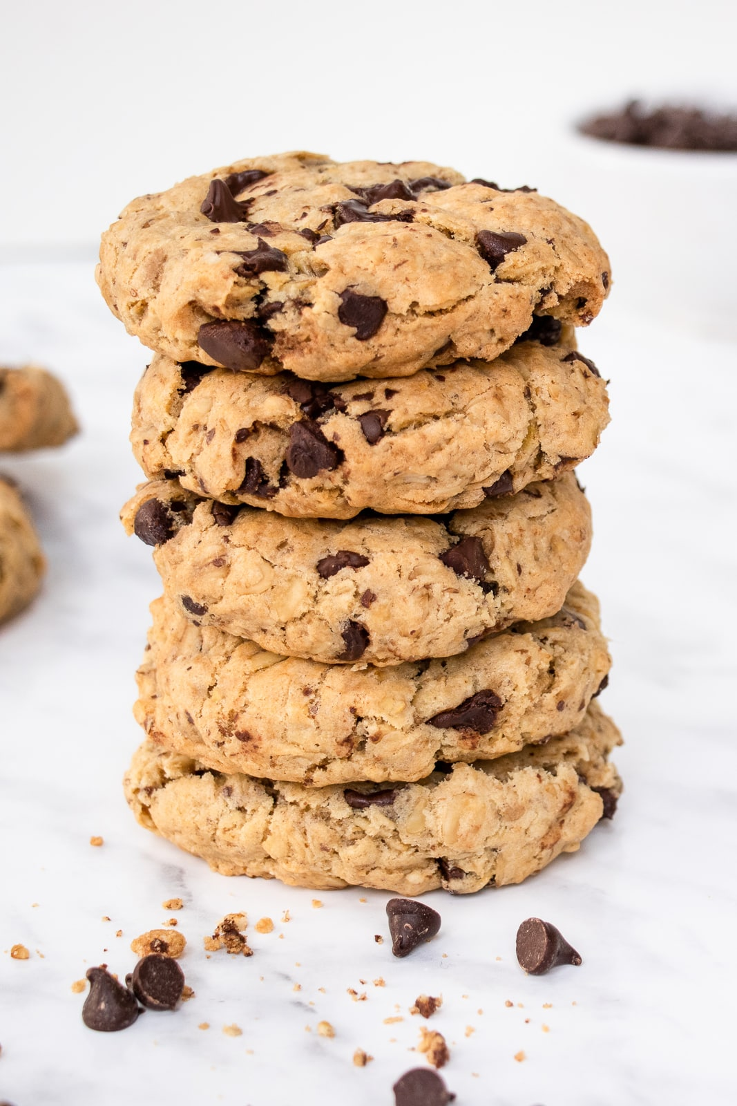 Close-up shot of a stack of 5 thick oatmeal chocolate chip cookies