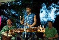 Sekou Camara playing instruments