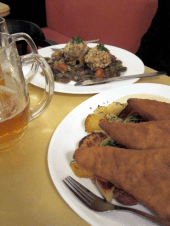 Vegan schnitzel in the foreground; mushroom goulash in the back