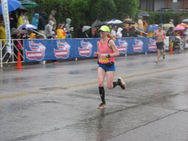 Me running toward the finish line of the Kentucky Derby Festival Mini Marathon (in the rain, but still smiling) - Louisville, KY