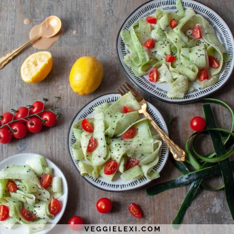 Peeled Cucumber Salad with Tahini, Lemon Juice, Cherry Tomatoes, and Black Sesame Seeds - by Veggie Lexi