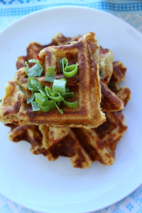 Savory Potato Waffles are a spicy, crisp on the outside, fluffy within grab and go breakfast or lunch treat. Make extra and freeze them to enjoy later.