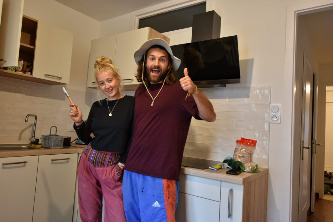 Couple in new apartment kitchen