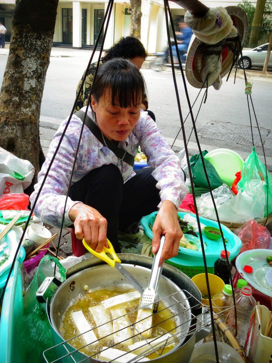Women frying tofu in Hanoi