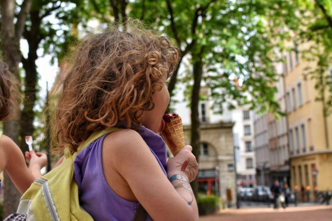 Child eating ice cream in Lyon
