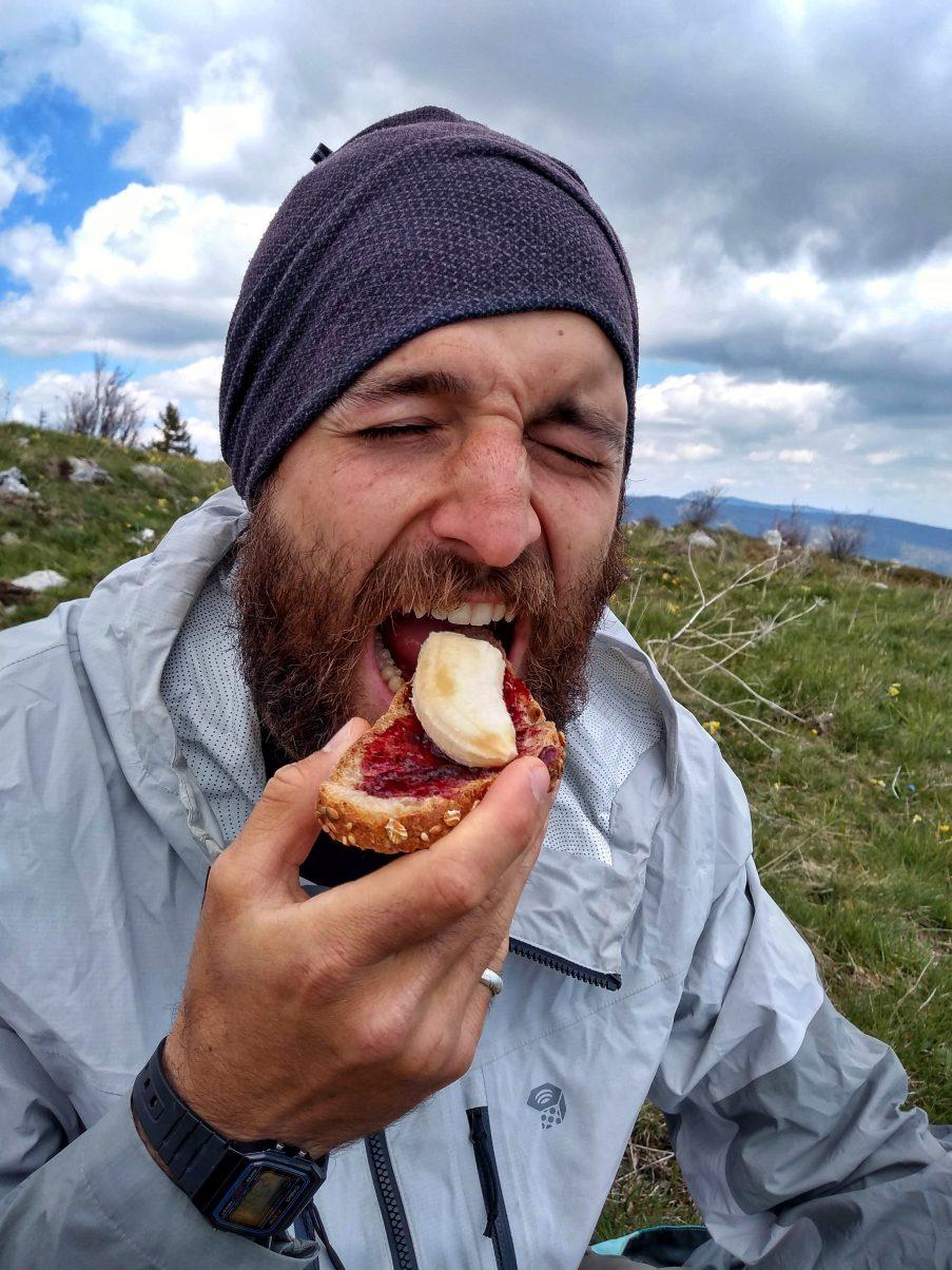 Man eating vegan hiking food