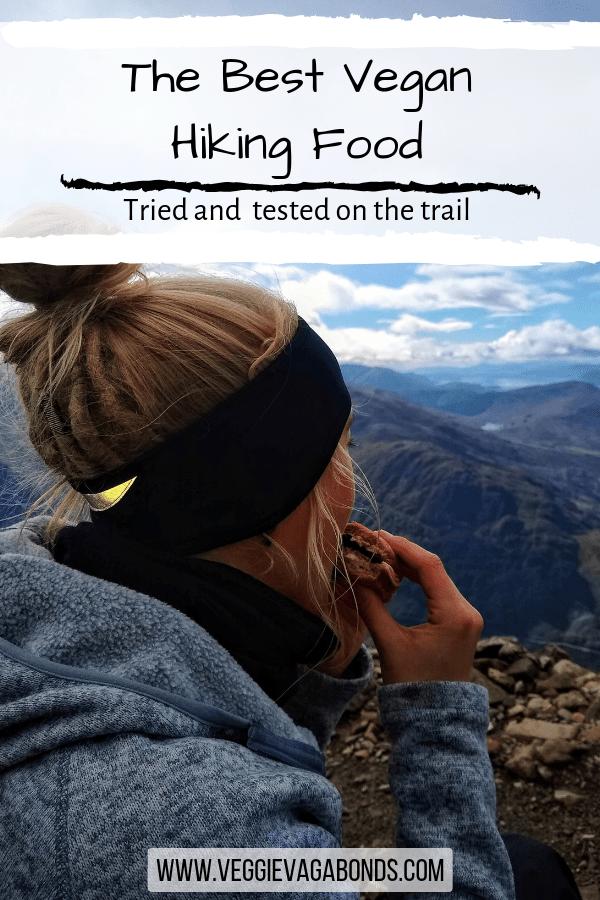 Girl eating vegan hiking food on hike