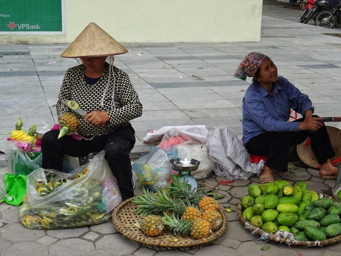 Two street fruit sellers in Vietnam