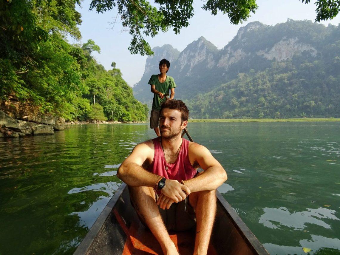 Man on Vietnamese boat Ba Be Lake