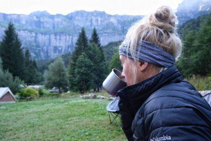Girl camping drinking coffee