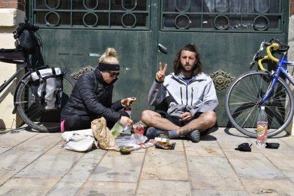 Two vegan cycle tourer having a picnic
